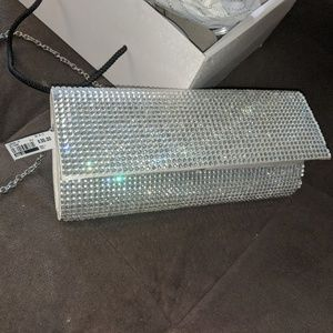 Sparkly silver clutch with removable chain strap